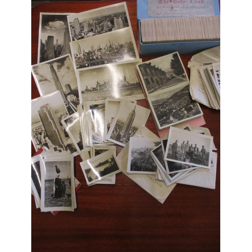 130 - 1930's assorted souvenir photo packs, postcards and slides includes views of New York, Niagara Falls...