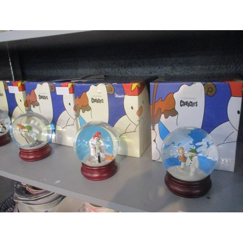 131 - Four Coalport characters, snow globes of The Snowman (with boxes) Location: 5:3...