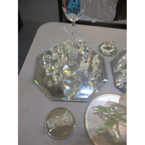 135 - A collection of Swarovski model animals and mirrored trays Location: 8:2...