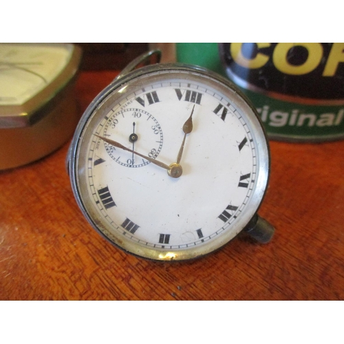 139 - A silver pocket watch and other items to include two mid 20th century bedside clocks Location: RWB...