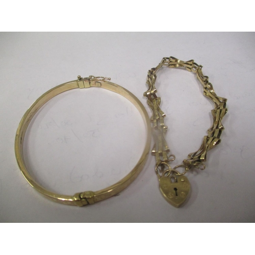 2 - A 9ct gold bracelet with heart shaped locket together with a 9ct gold bangle, 9.7 grams Location: CA...
