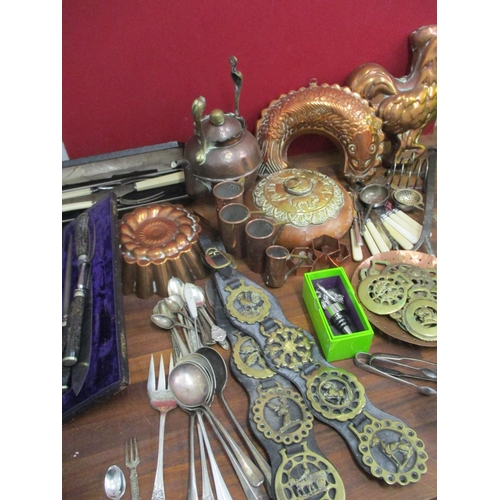 21 - Metalware to include copper jelly moulds, an Arts & Crafts kettle, cutlery and flatware, silver plat...