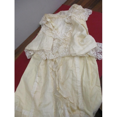 23 - Table linen, christening gowns, early 20th century boy's cotton shirt and a cream silk and lace cape...