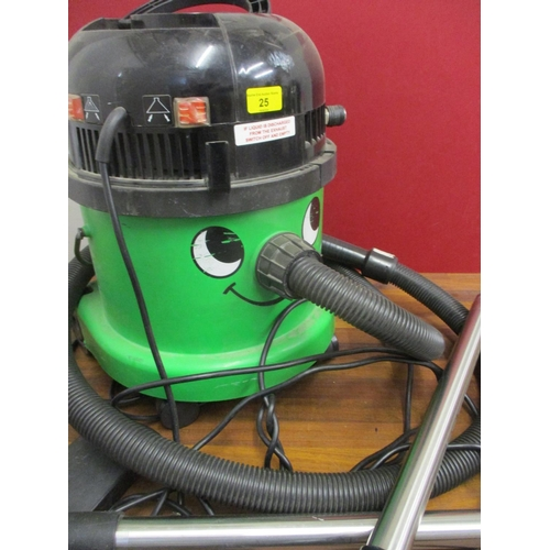 25 - A green George Hoover vacuum cleaner with attachments Location: LWB...