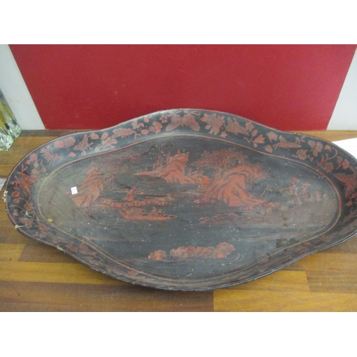 32 - A large Oriental black papermache tray with red painted scenes Location: BWR...