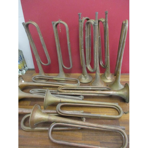 34 - Twelve mixed military bugles to include B.B.I.M Ltd examples in copper and brass Location: RWM...
