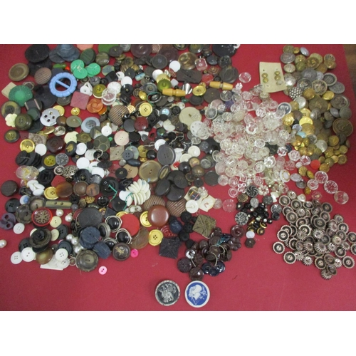 37 - A collection of early 20th century fabric covered buttons, military and blazer buttons, vintage butt...
