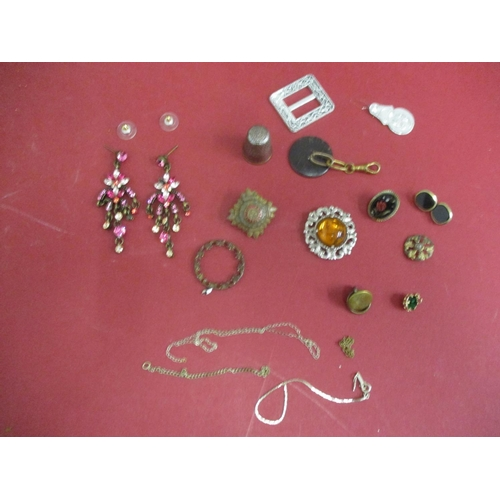 39 - A quantity of mixed early to mid 20th century shirt studs, chains, buckles and other items to includ...
