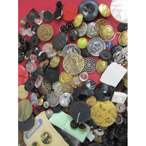 40 - A quantity of mainly black mixed vintage buttons together with two Artid buttons, metal examples and...