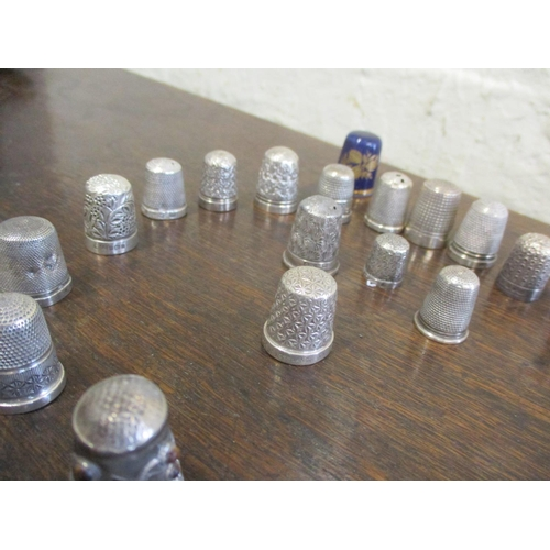 53 - A collection of thimbles to include silver examples. Total weight of metal thimbles, 102g Location: ...