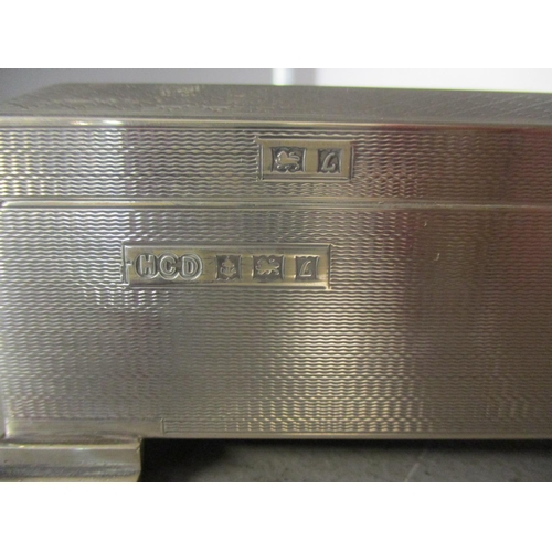 54 - A silver cigarette box, wooden lined, on four graduating feet. Total weight 573g Location: FSL...