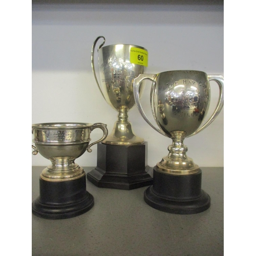 60 - Three silver trophy cups, 347g, on stands Location: 2:1...