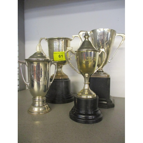 61 - Three silver trophy twin handled cups, two on stands and a silver plated trophy.  Total weight 468.9...