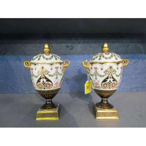66 - A pair of 19th century Wedgwood neoclassical covered urns, twin based garland ring and mask handles ...