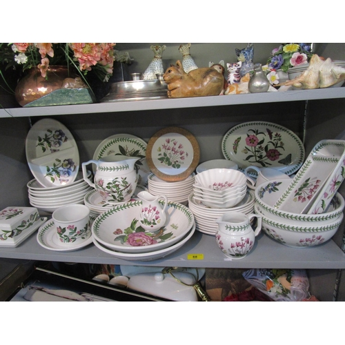 68 - A quantity of Portmeirion Botanical pattern tableware to include various bowls, plates, jugs and dis...