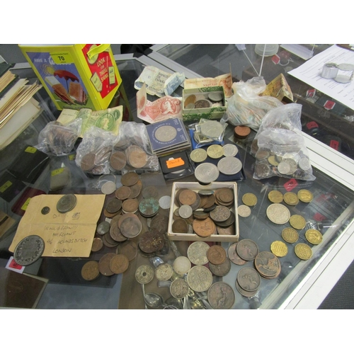 70 - A mixed lot of mainly British coinage, tokens, medals and bank notes to include Georgian copper penn...