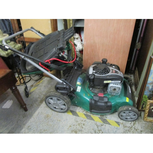 95 - A Qualcast petrol lawnmower Location: G...