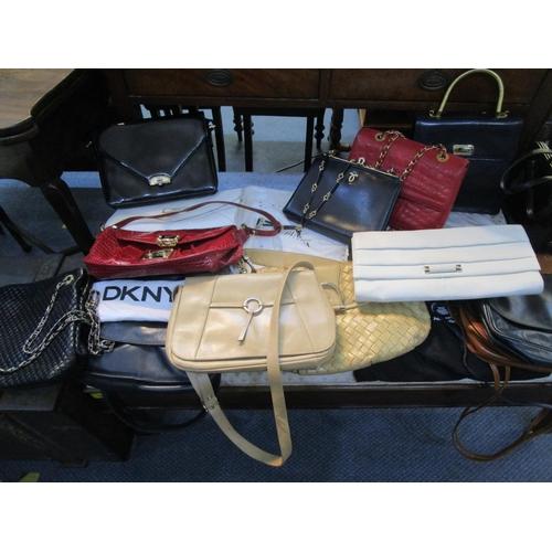 109 - A quantity of fashion handbags and clutch bags to include DKNY, Jane Shilton, Furla, Widegate London...