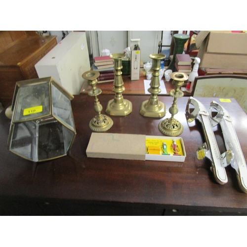 110 - A mixed lot to include two pairs of brass candlesticks, a hall lantern, boxed Dinky Toys no 49, petr...