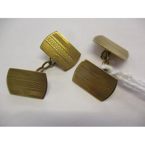 69 - A pair of 9ct gold cuff links with machine turned decoration, London 1947, marks for L W & G, 4.6 gr...