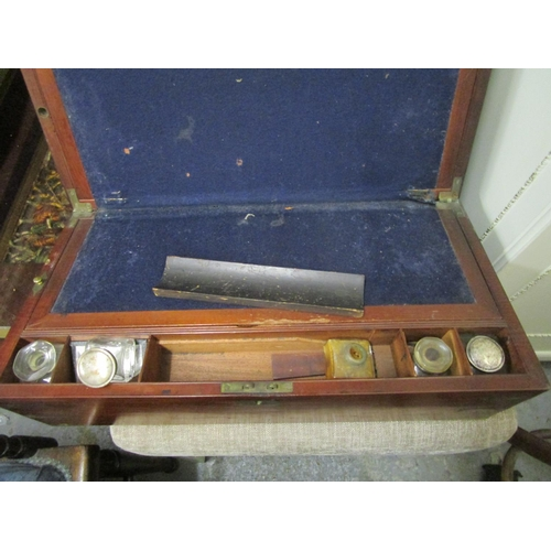81 - A Victorian mahogany writing box with brass bound corners, fitted interior with a pair of glass inkw...