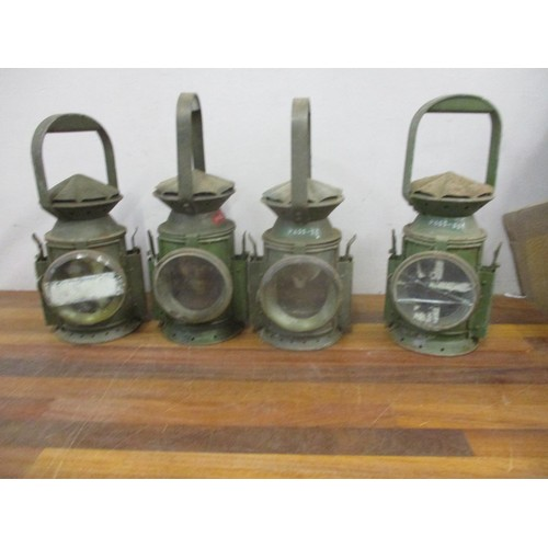47 - A group of four green painted oil railway lamps, circa 1940s Location: G...