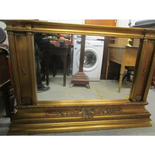 83 - A contemporary gilt framed over-mantle mirror, a stepped top over a shell motif and scrolled leaf re...