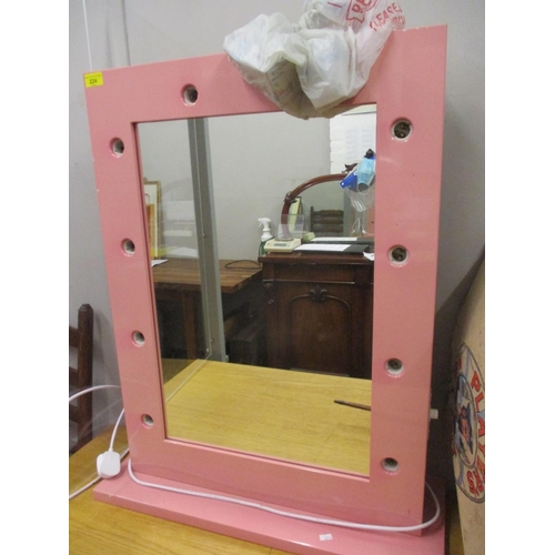 224 - A contemporary pink, free standing mirror with electrics to fit ten light bulbs, to the surround, to...