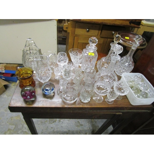 342 - A mixed lot of glassware to include two Caithness glass paperweights, cut glass decanters, various d...
