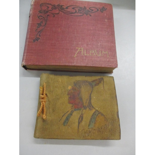 344 - Two small photo albums containing WWI photographs of military personnel 1914, moon photographs 1912 ...