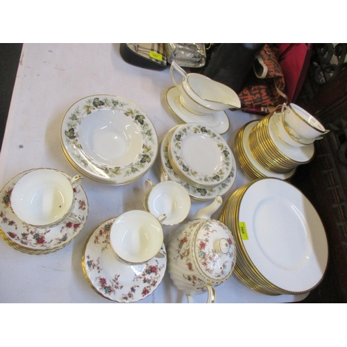360 - A Minton Golden Heritage part dinner service having a white ground with gold coloured rim, together ...