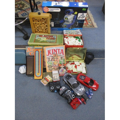 371 - A mixed lot of toys and games to include a programmable robot, boxed, board games, diecast toy cars ...