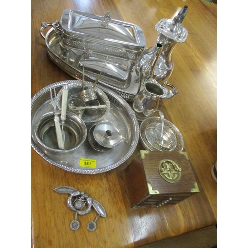 381 - A quantity of silver plate and white metal items to include a plaque stamped 500 in the form of two ...