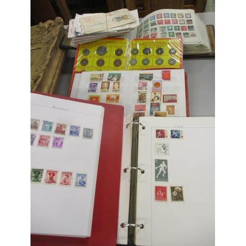 385 - Three stamp albums from around the world and a quantity of first day covers, together with a stamp a...
