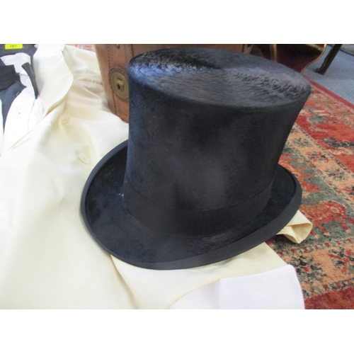 387 - A Dunn & Co top hat in a leather case, a walking cane and a white dinner suit Location: BR...