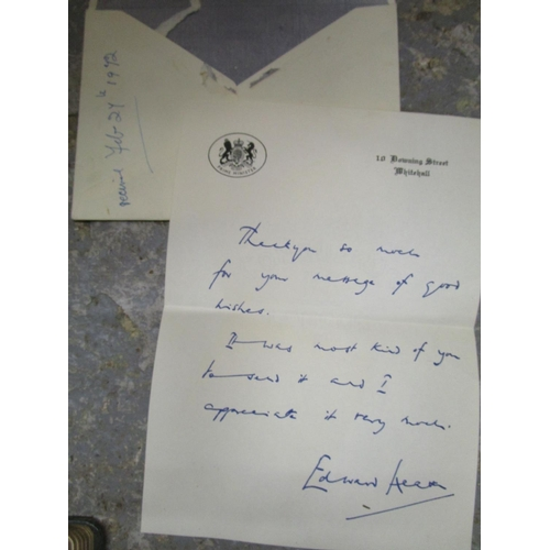 402 - A lot of ephemera to include a signed letter by Edward Heath on No10 Downing Street notepaper, an au...