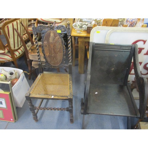 225 - A 1920s oak cross framed stretcher chair, together with a barley twist framed can chair Location: C-...