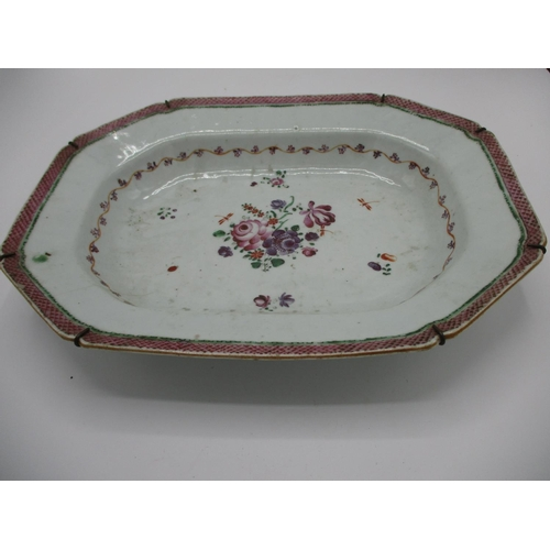 11 - A late 18th century Chinese meat dish decorated with flowers to the centre, a band of flowers and cr...