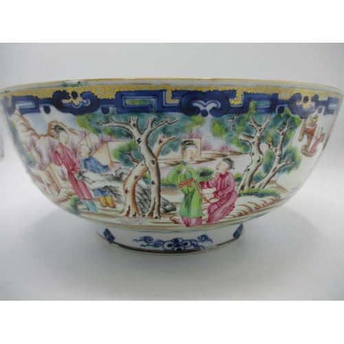 12 - A late 18th century Chinese bowl decorated with panels of figures in garden settings and landscapes ...
