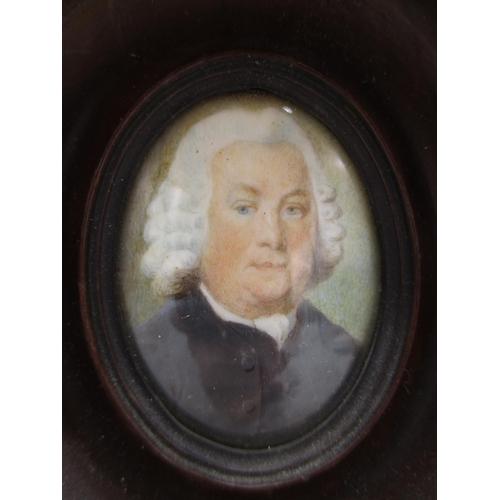 136 - Two 18th century portrait miniatures, each of a man wearing a wig, a white shirt and a black jacket,...