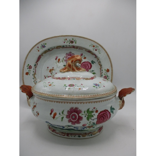 14 - A late 18th century Chinese tureen and cover and a matching meat plate decorated with blossoming bra...