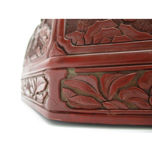 24 - A large 19th century Chinese cinnabar box of octagonal form, the domed lid decorated with panels of ...