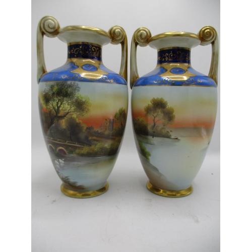25 - A pair of Japanese Noritake vases of baluster form with twin, spiral handles, decorated with river s...