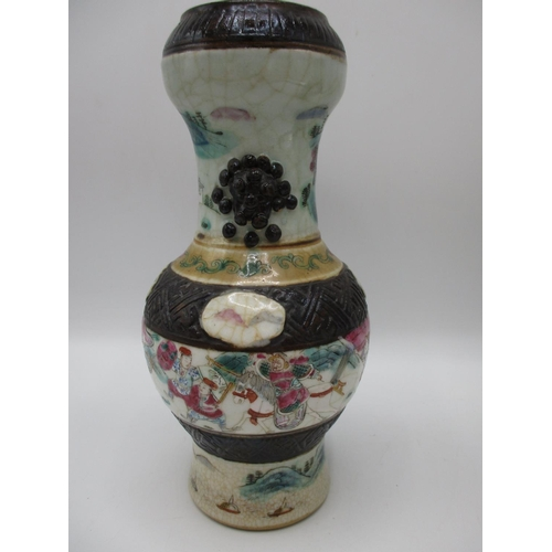 3 - A pair of 19th century Chinese Nankin crackle glazed famille rose vases of bulbous form, decorated w...