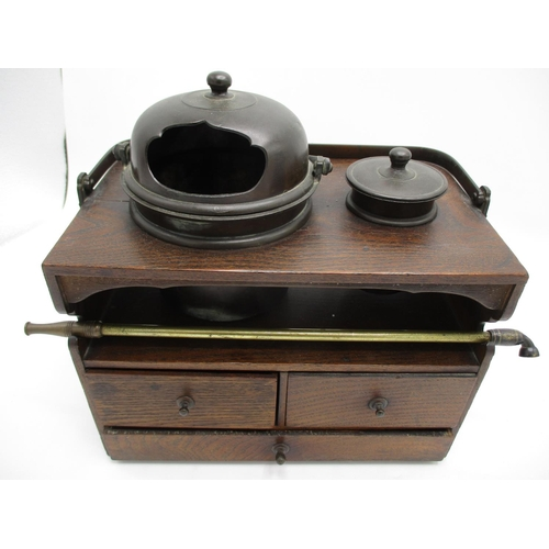 34 - A late 19th century Chinese elm and bronze opium chest, with a swing handle, two lidded pots and a p...