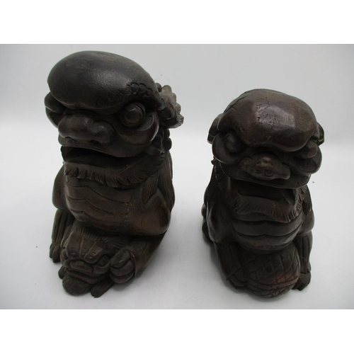 36 - A 20th century Chinese carved wooden foo dogs with a ball, 7