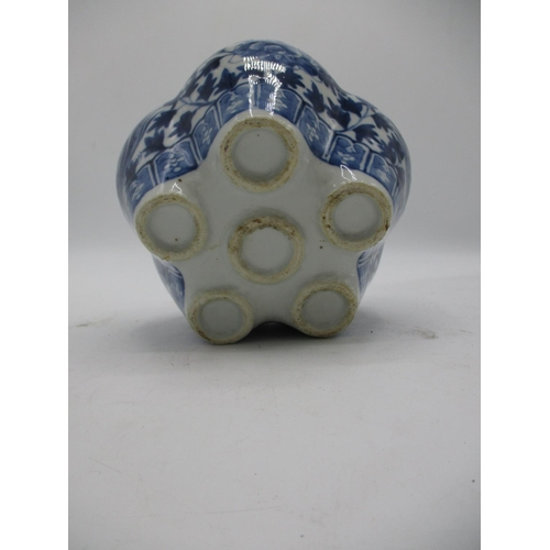 39 - A 19th century tulip vase with a central column and five apertures below, on a lobed body, decorated...