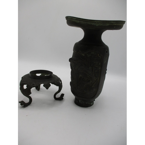 40 - A pair of 19th century bronze vases with broad rims and cylindrical bodies decorated with panels of ...