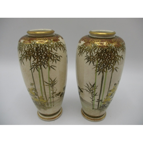 7 - A pair of Japanese Meiji period Satsuma vases of tapered form, decorated with birds in flight, flowe...