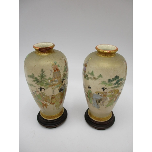 9 - Japanese Meiji period Satsuma miniature vases, comprising a pair decorated with figures in a landsca...